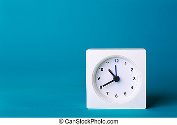 white clock on a yellow background