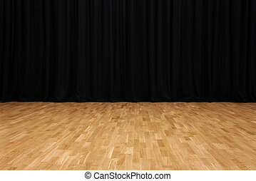 Small stage with black velvet theater curtains