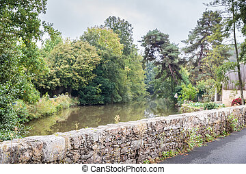 small stone bridge in the city center of Rocheserviere, France