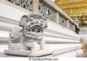 Small stone statue of a lion