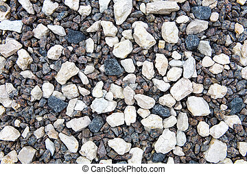 Small stones lie on the ground.