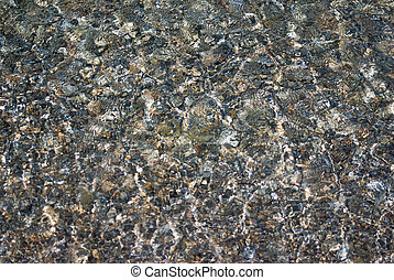 Small stones under the water surface