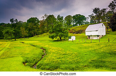 Small stream and farm in rural Baltimore County, Maryland.