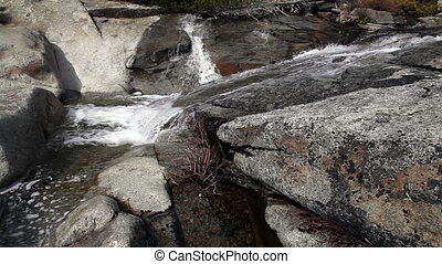 Small Stream Flowing Over Granite