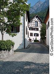 Small street in Vaduz, Liechtenstein. GPS information is in ...