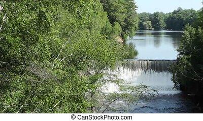 small suburban dam - A suburban dam backs up water to a...