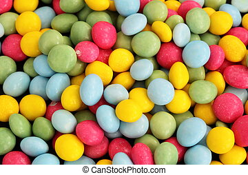 small sugar coated cake decorations that could be used as a background
