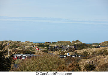 small summer houses by the beach in denmark