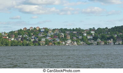 """small swedish village view from ship board, near stockholm, sweden"""