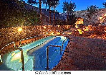 Small swimming pool illuminated at night