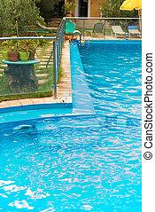 Small swimming pool in tropical resort.