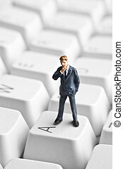 Small technology business - Businessman figurine placed on...