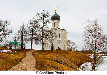 Small temple on the background of a winter landscape in Russia.