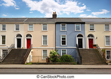 small three-story house stands beside road. doors, windows, ...