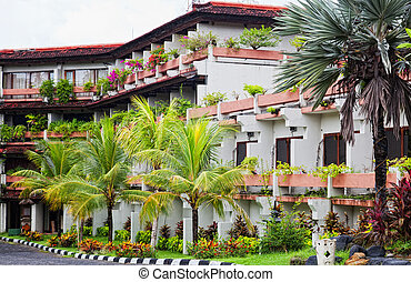 Small three-storyed modern hotel in tropics