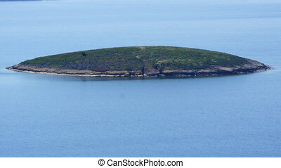 """Small tiny island in mediterranean aegean sea, foca, izmir, turkey"""