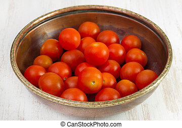 small tomato in old dish