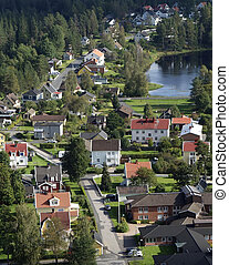 Bird wiew over small town main street. Real estate living close to nature with fresh air. Unique bird view concept.