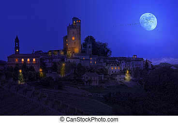 Small town on the hill at night.
