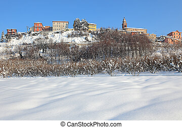 Small town on the hill covered by snow.