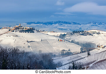 Small town on the hills covered in snow in Italy.