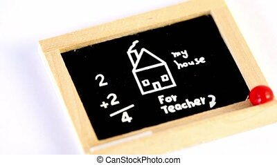Small toy blackboard spins with drawing, inscription and...