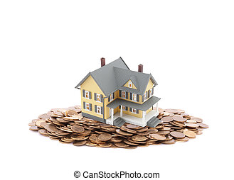 Small toy house on a pile of coins