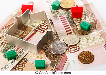 Small toy houses and russian rubles