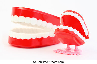 small toy jaw with white teeth and big jaw swallowing mechanism on white background