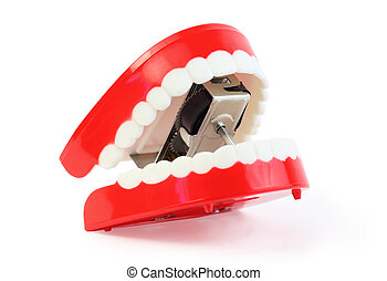small toy jaw with white teeth swallowed mechanism on white background