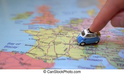 Small toy retro car on Europe map in France. Travel by car ...