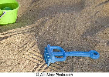 small toys on the beach