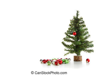 Small tree with ornaments on white