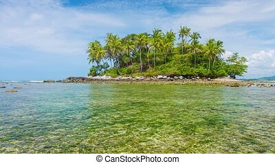 Small Tropical Island at Low Tide under Cloudy Skies - Video...