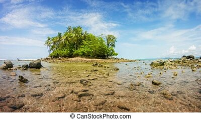 Small Tropical Island from across Crystal Clear Shallows in...