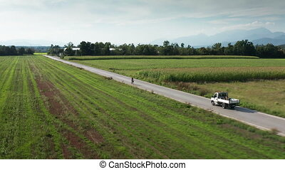 Small truck on rural road - Aerial shot of a small truck ...