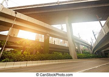 Small truck speeding under industrial bridges. Long exposure, bu