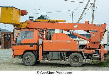 Small Truck with Hydraulic Boom.