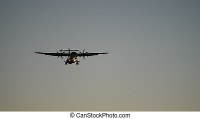 small turbo-prop communter airplane flying in sky