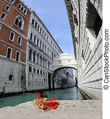 small venetian mask and the bridge of sighs on the background in