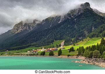 Small village and alpine lake in Switzerland.
