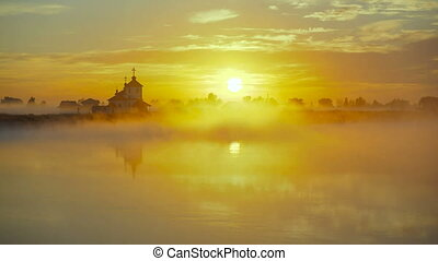 small village church at the foggy morning. Sunrise time....