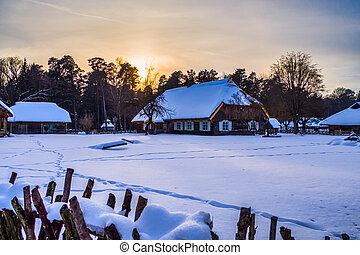Small Village Covered with Snow in the Winter Evening