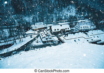 Small village in snowy mountains at winter night.
