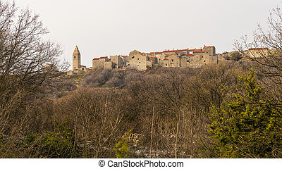 Small village of Lubenice on a cloudy day in spring