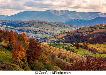small village on hills in autumn. lovely countryside of...