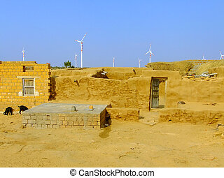 Small village with traditional houses in Thar desert, India