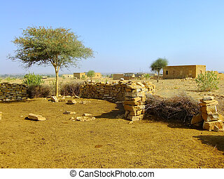 Small village with traditional houses in Thar desert near Jaisal