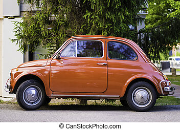 Small vintage italian car Fiat Abarth. Red color