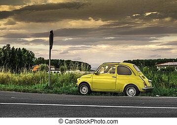 Small vintage italian car Fiat Abarth. Yellow color